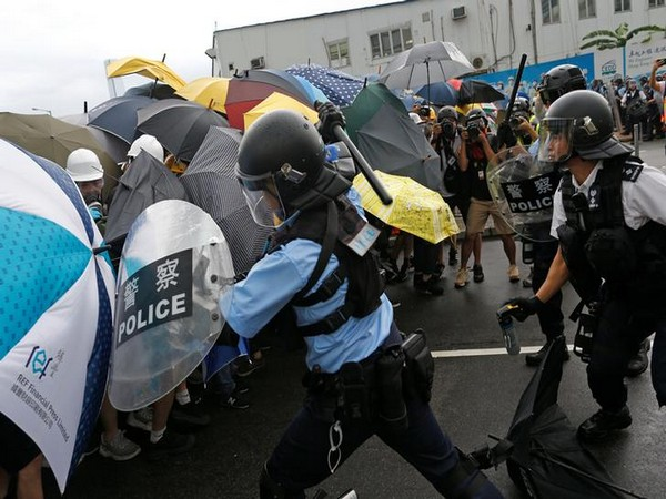UPDATE 1-Hong Kong protesters rampage as police call for curfew
