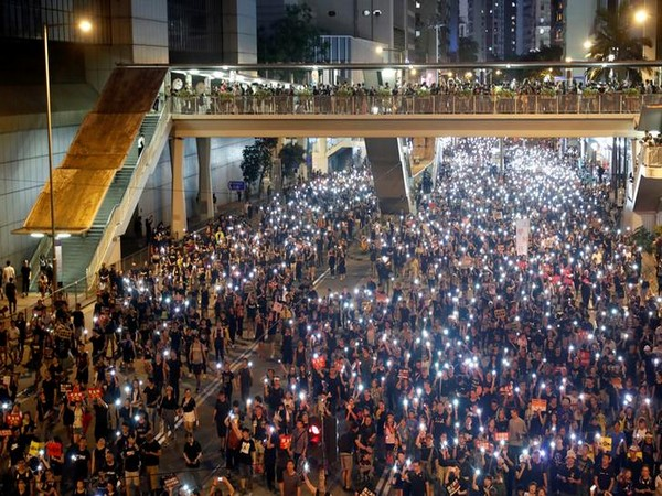 UPDATE 1-Thousands protest in Hong Kong, China media warns Beijing will not let situation continue