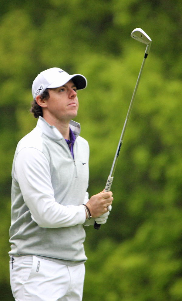 Golf-McIlroy nearly leaves red-hot putter in Canada