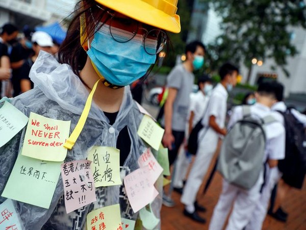 UPDATE 4-Hong Kong children form chains of protest as economic worries grow