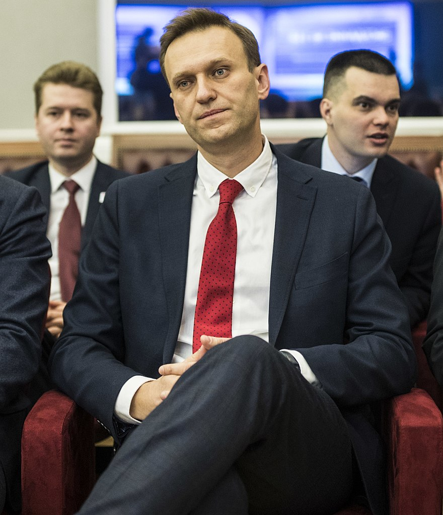 Kremlin critic Navalny's apartment seized, his aide says