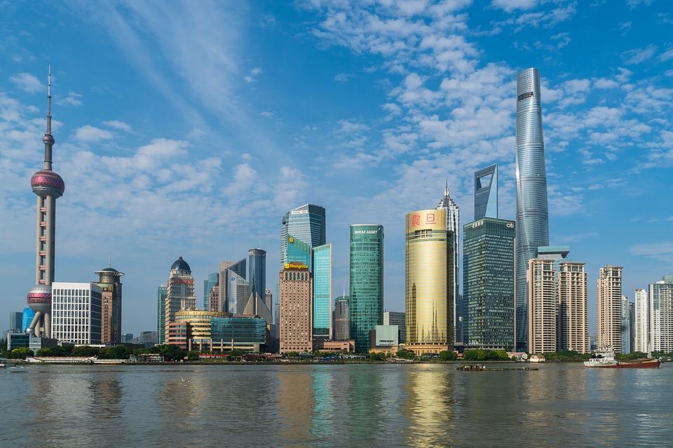 Soccer-Port down Shenhua in Shanghai derby to increase Super League lead
