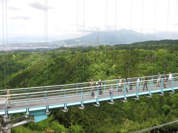 CORRECTED-Indonesia to build country's longest bridge linking islands near Singapore