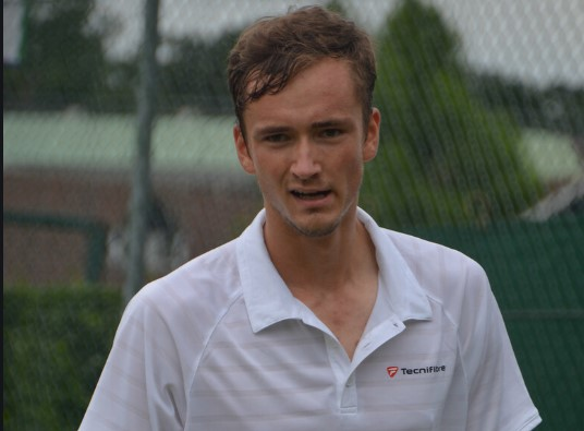 Tennis-Fourth seed Medvedev sent packing by Fucsovics