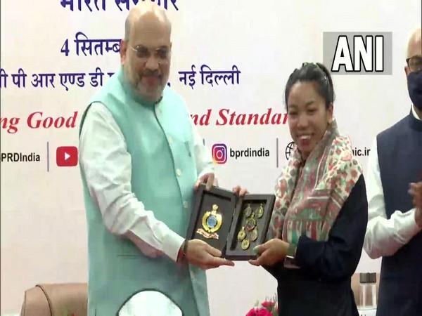 Amit Shah felicitates Olympics medalist Mirabai Chanu in Delhi