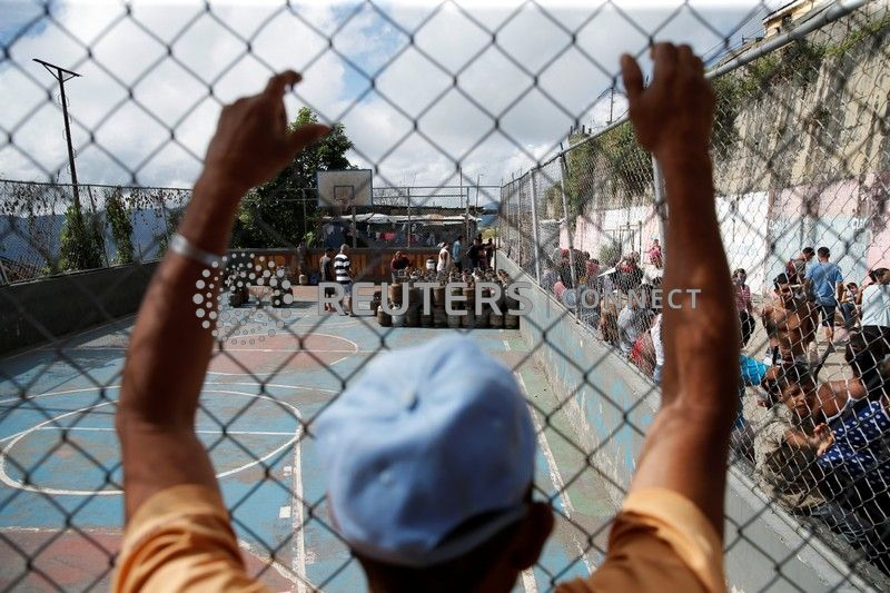 Gas cans are seen placed at a sports field at the low-income neighborhood of Filas de Mariche in Caracas