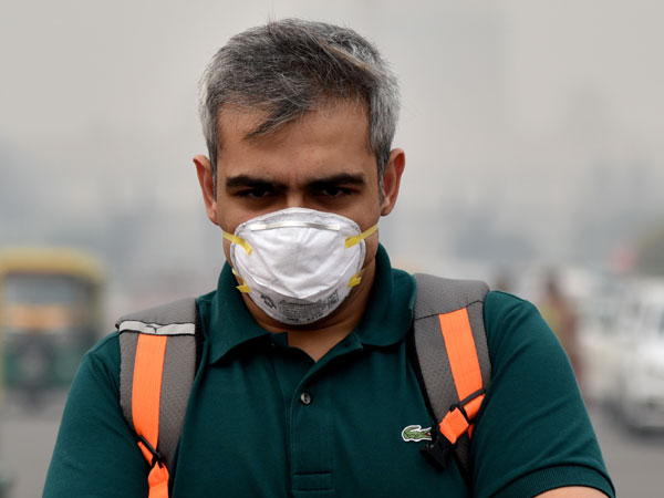 FEATURE-Amid 'air apocalypse', mask-clad Lahore looks for answers