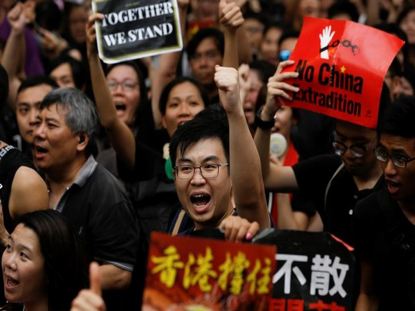 Hong Kong police fire tear gas as protesters defy emergency law