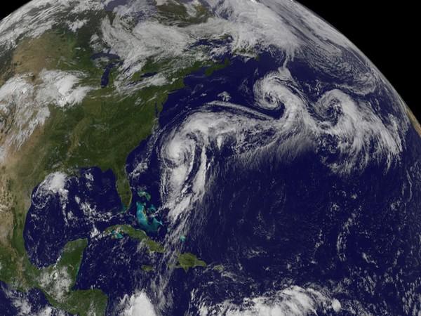Hurricane Epsilon weakens, expected to move east of Bermuda