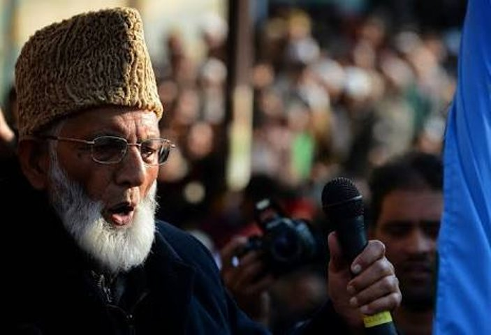 India locks down restive Kashmir after burial of separatist leader