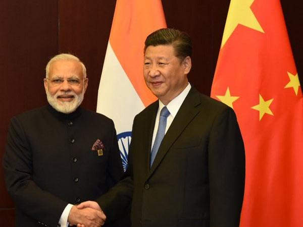 Modi, Xi meet for second day of informal talks