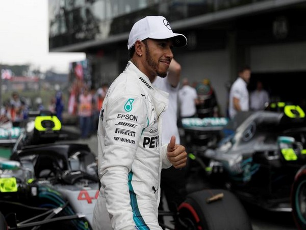 Motor racing-Hamilton defends his 'Britishness' ahead of home race