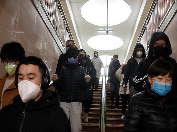 Chinese city eases virus lockdown but life is far from normal