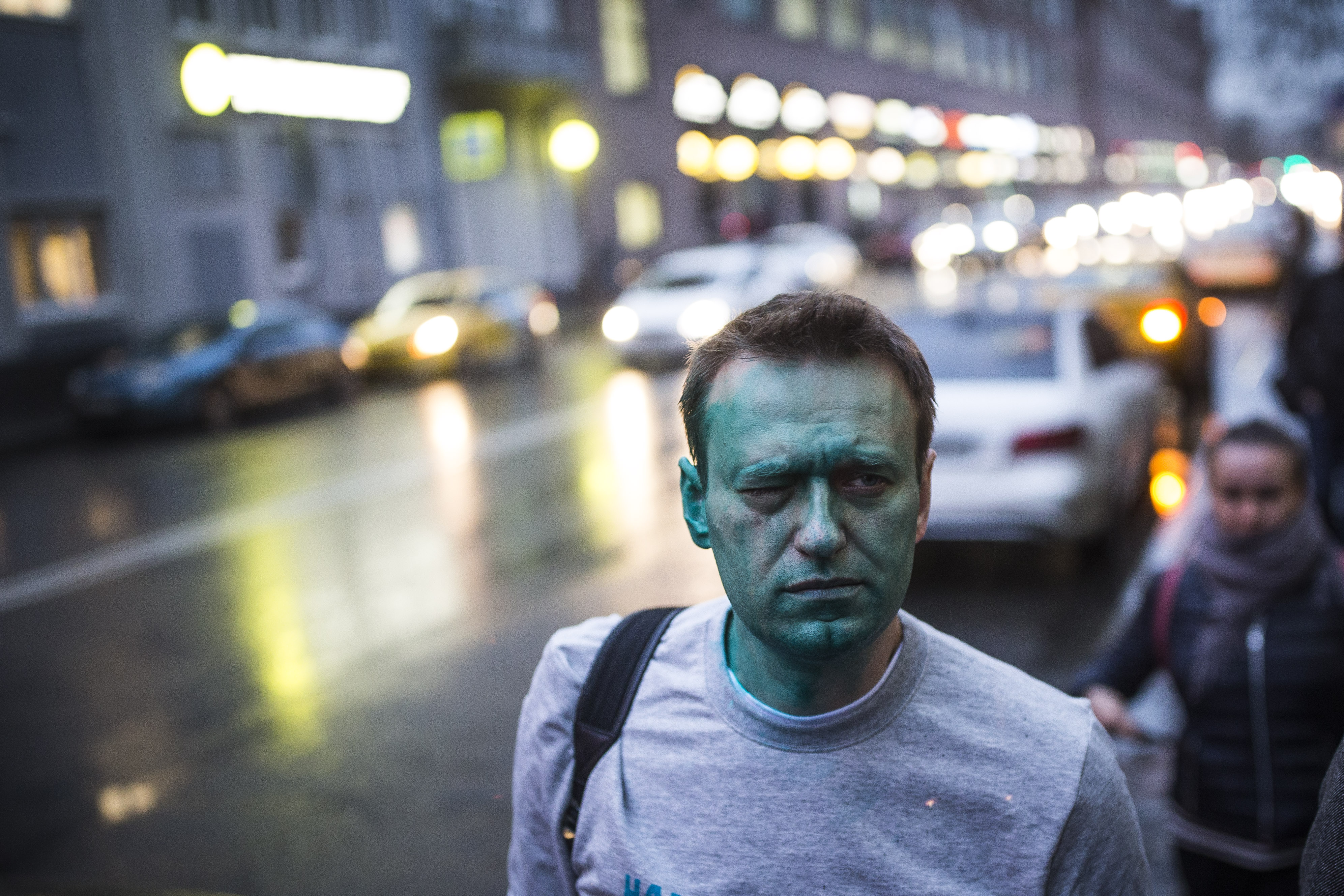 UPDATE 1-Russia carries out mass raids on Kremlin critic Navalny's supporters