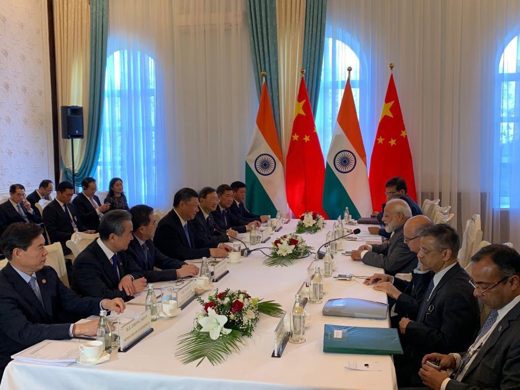 UPDATE 1-China's Xi and India's Modi discuss proposals to improve ties hit by Kashmir