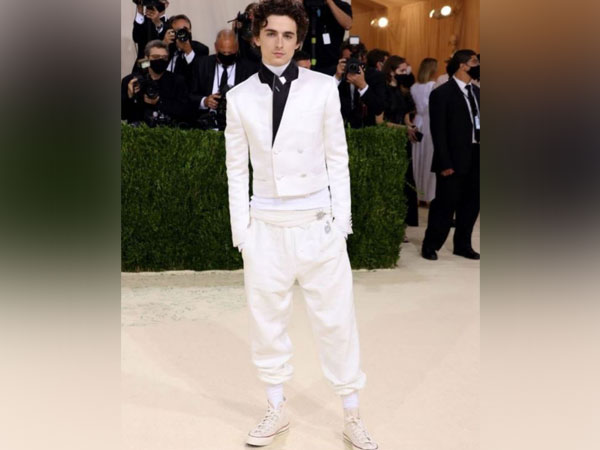Timothee Chalamet makes his Met Gala debut in an all-white outfit and sneakers