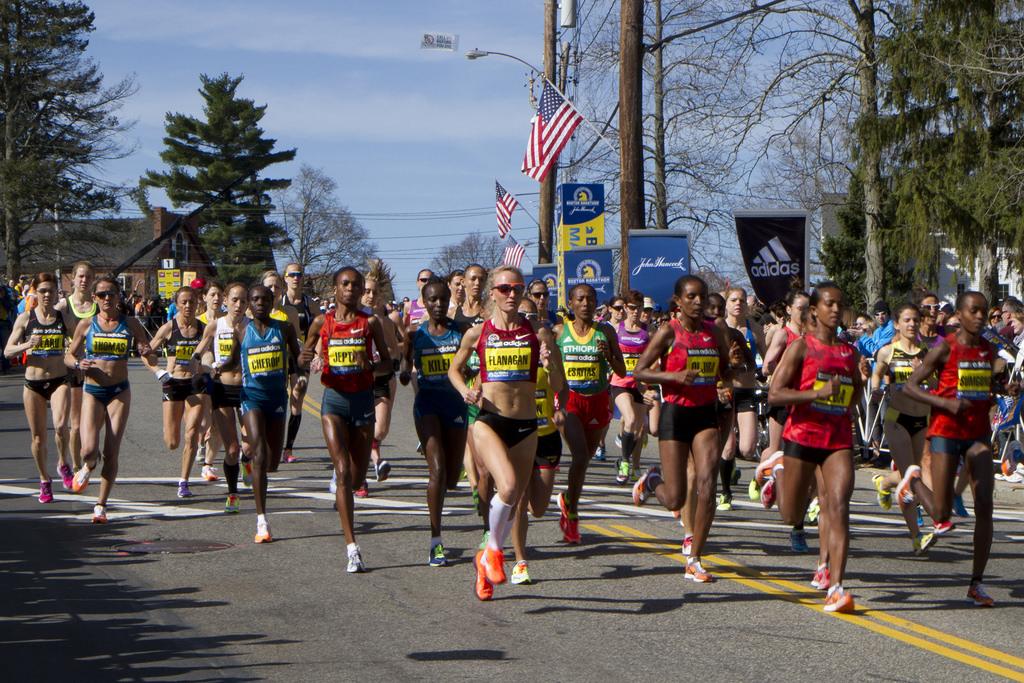 Athletics-Misty morning, smattering of fans greet Kipchoge's two-hour marathon attempt