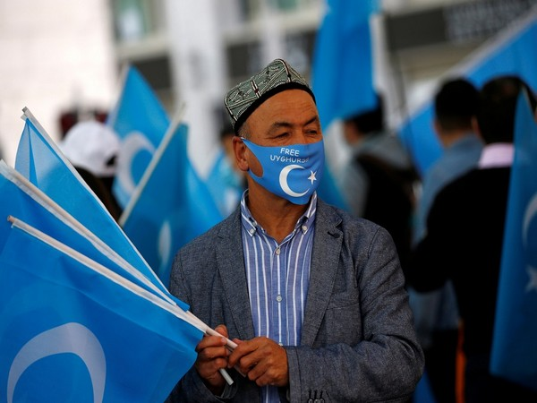FEATURE-Defying Chinese surveillance, young Uyghurs abroad speak up online