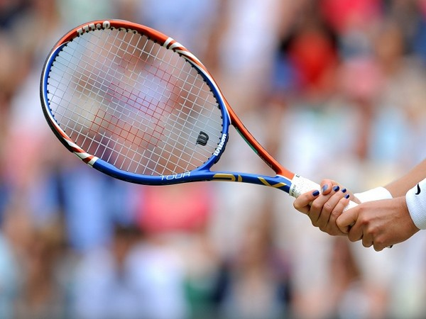 Tennis-Positive COVID-19 tests linked to Australian Open downgraded to eight