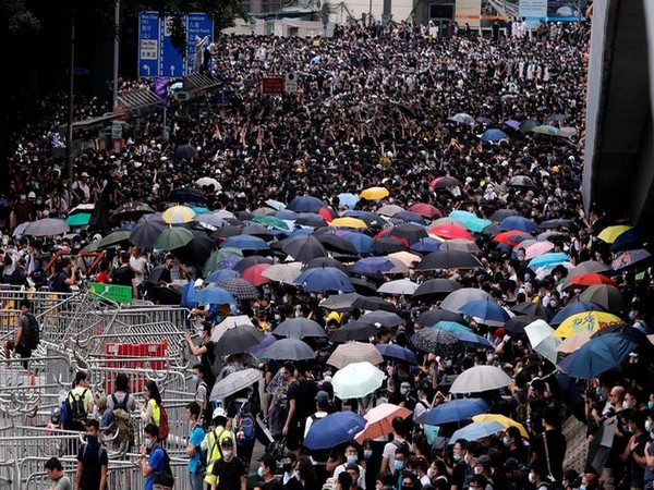 Hong Kong protesters plan mall sit-ins after hill-top human chains