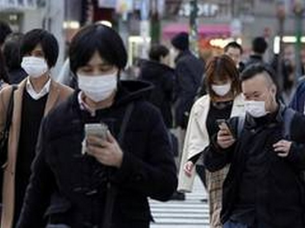 Cases in Japan hit record amid holiday travel