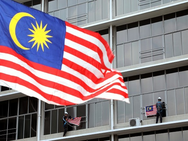 Malaysian police nab 18 Chinese nationals over online cheating syndicate