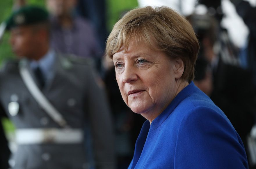 German Chancellor Merkel says planned exit won't hurt her influence abroad