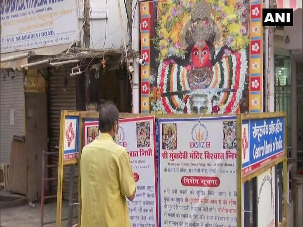 Mumbai: Devotees pray outside Mumba Devi Temple on Ashtami amid COVID-19 restrictions