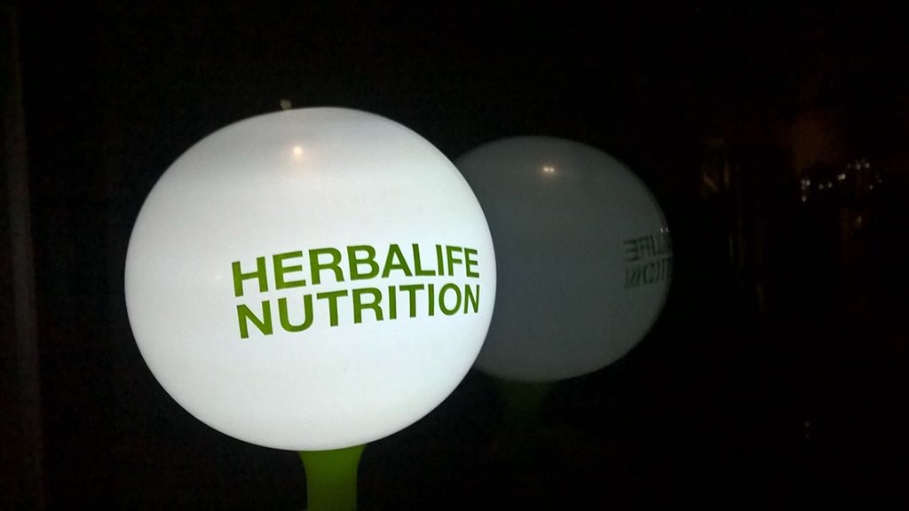 UPDATE 2-U.S. charges two former Herbalife executives in China over bribery scheme -source