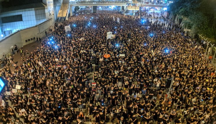 After scuffles, Hong Kong police warn protesters to refrain from violence, leave scene