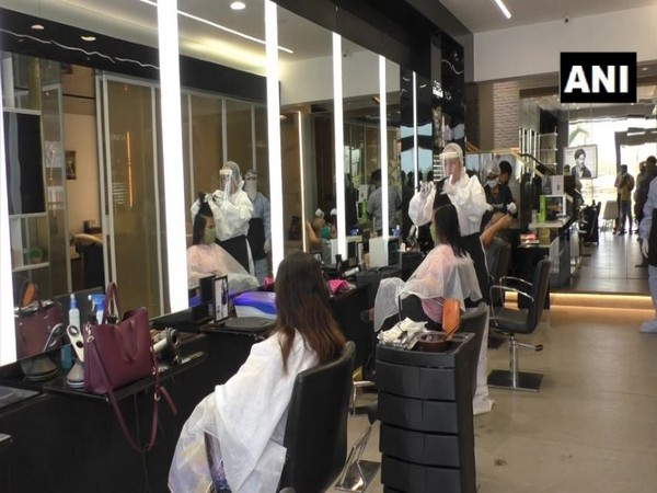 French flock to hair salons before new lockdown takes effect