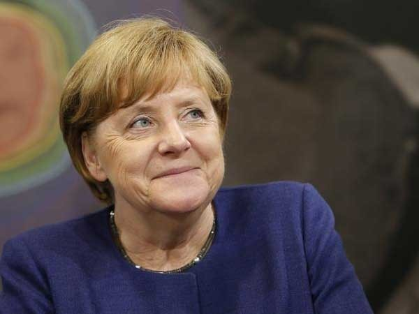 Activists protest German coal plans at Merkel party HQ