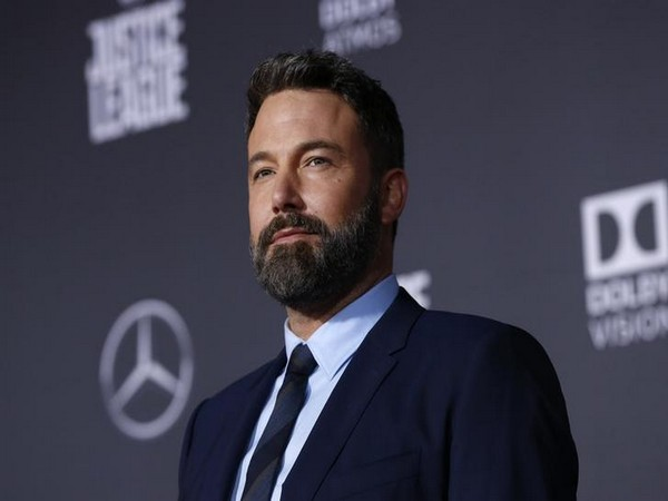 Ben Affleck balances packages, coffee while attempting to keep pants up