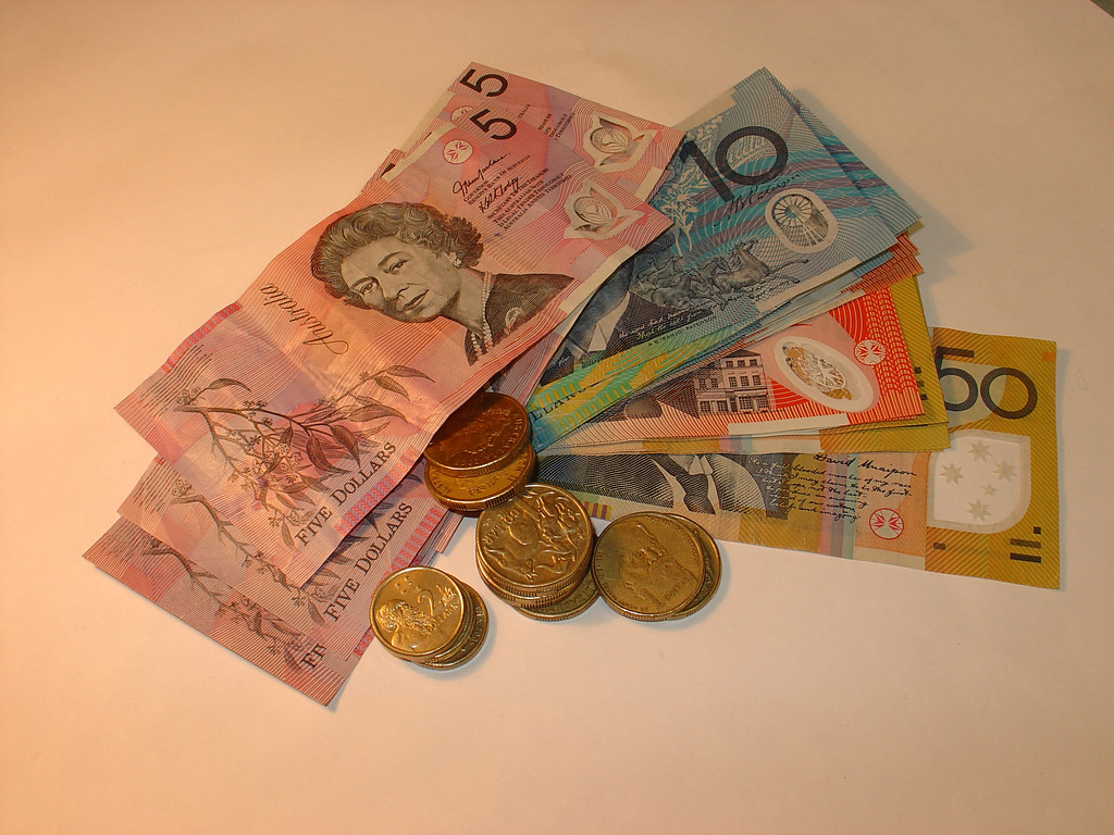 Aussie dollar slips to four month low as traders await for economic data