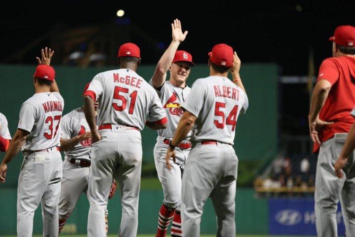Thomas' slam rallies Cardinals past Pirates