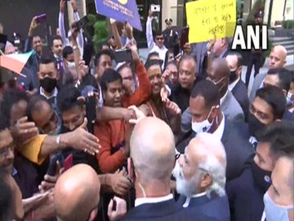 PM Modi meets crowd gathered outside New York hotel