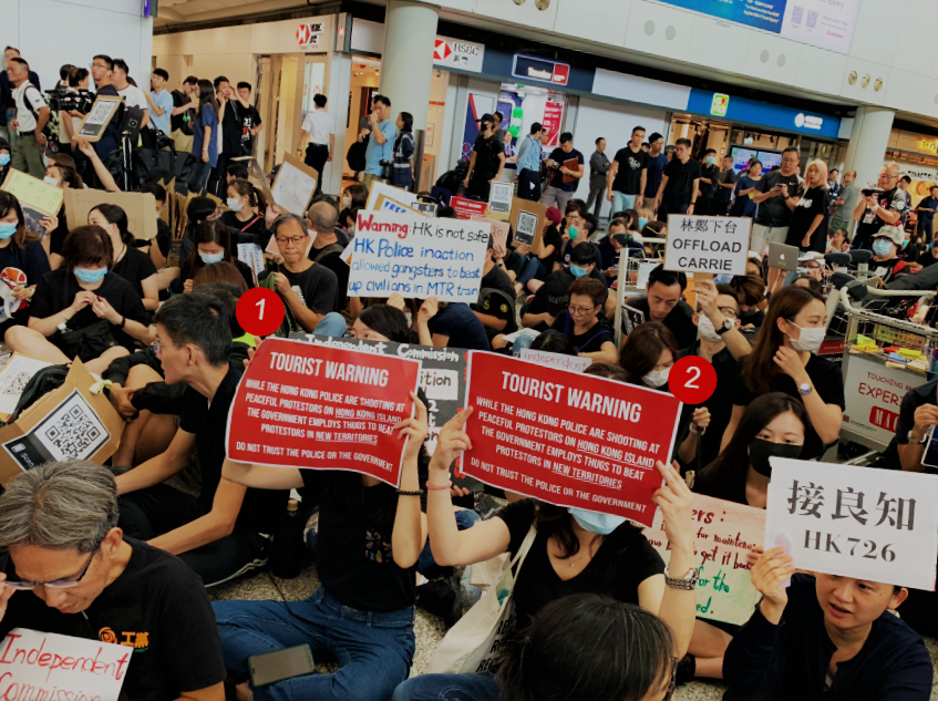 UPDATE 3-'Democracy now': Protesters stage sit-in at Hong Kong airport