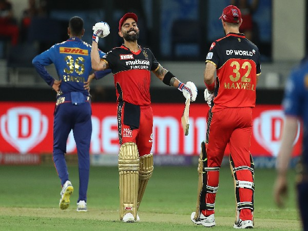 IPL 2021: Maxwell, Kohli power RCB to 165/6 against MI