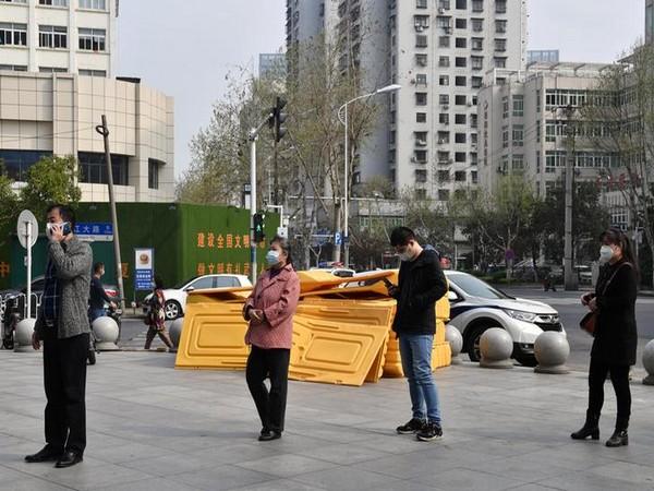 Divided city: rows of fences split coronavirus-scarred Wuhan