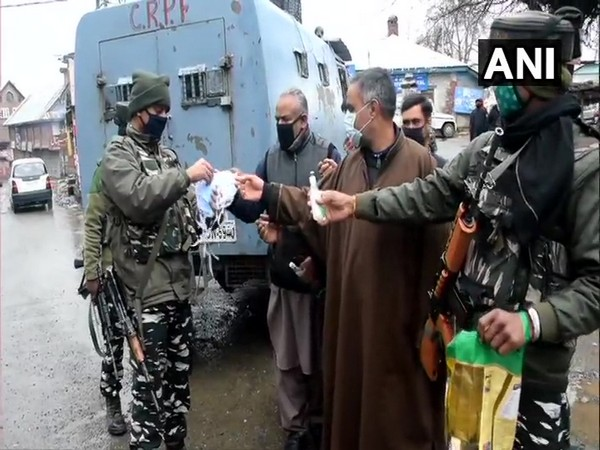 COVID-19: Jawans of 14th Battalion CRPF distribute masks to locals in Shopian