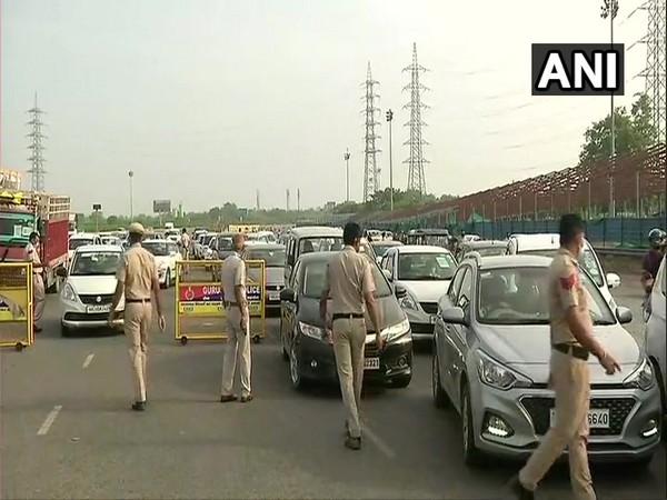 Heavy traffic movement at Delhi-Gurugram border; Police check passes, IDs of commuters
