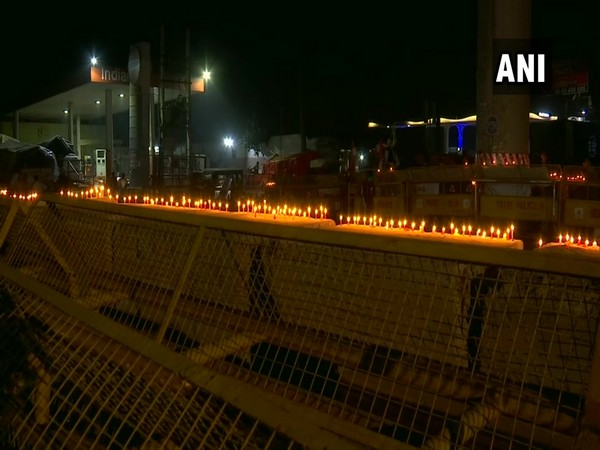 Protesting farmers celebrate Guru Nanak Jayanti, light candles on security barricades