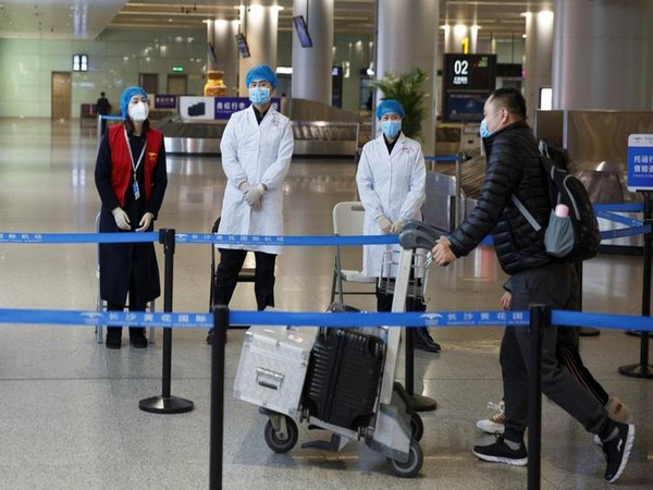 WRAPUP 8-Americans disembark from virus-hit cruise; China says new cases slow