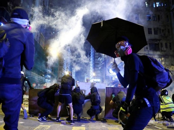 UPDATE 2-Thousands of protesters throng streets of Hong Kong as government urges calm