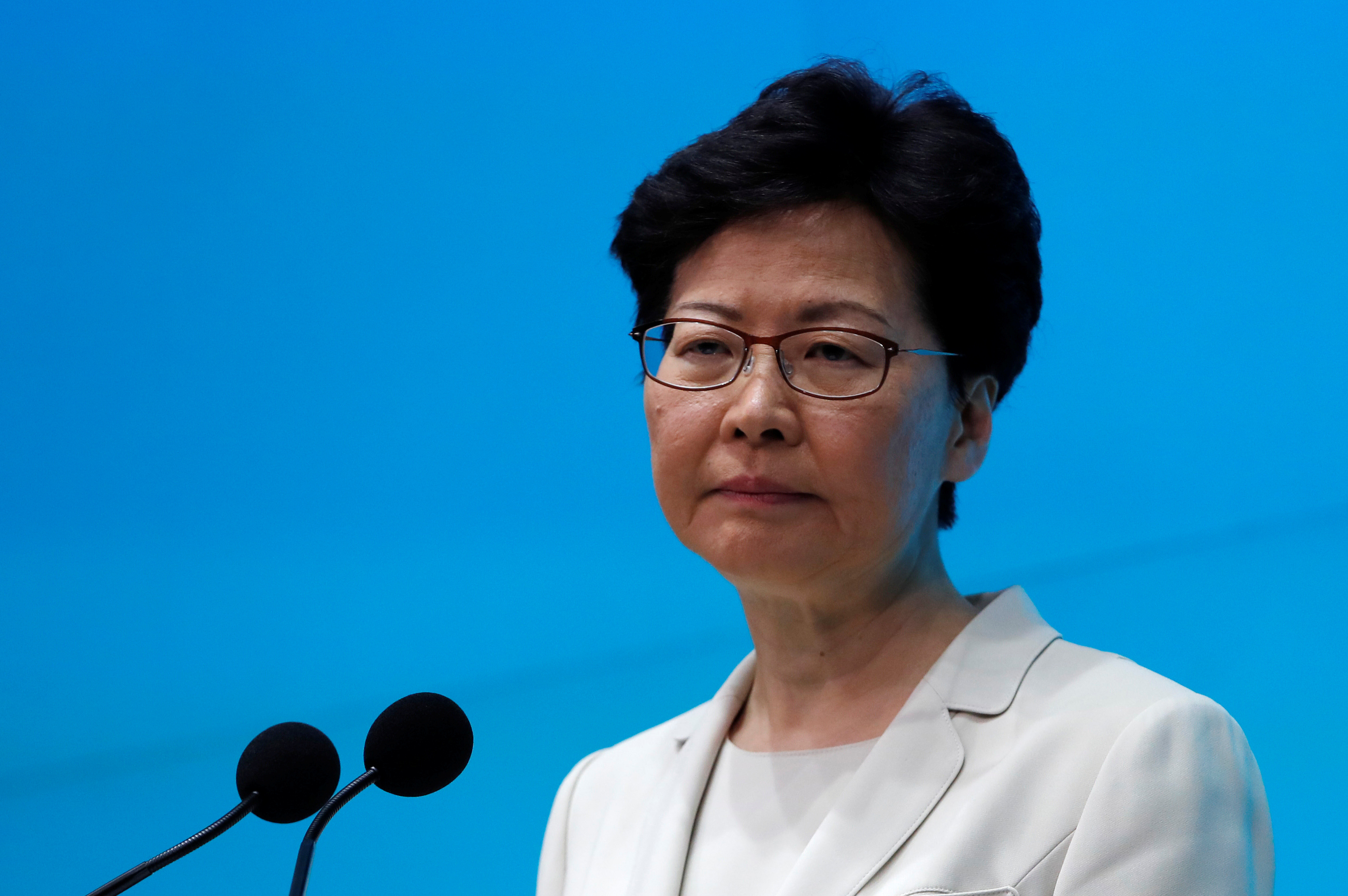 UPDATE 3-Hong Kong leader Lam does not rule out Beijing help, as economy suffers