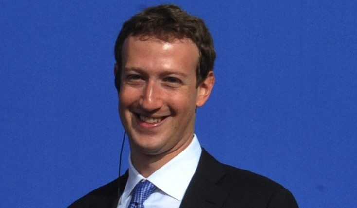 UPDATE 1-Treat us like something between a telco and a newspaper, says Facebook's Zuckerberg